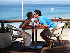 Couple kissing seaside restaurant