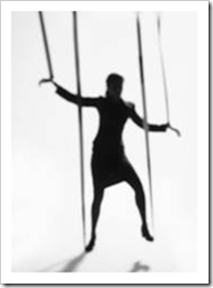 Silhouette of a woman tied to strings like a puppet