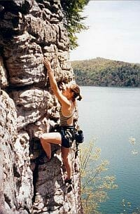 Teenage girl rock climbing