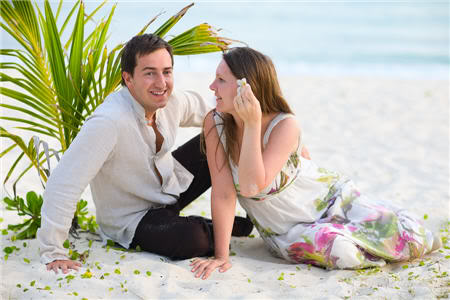 Couple on beach, happy after relationship coaching