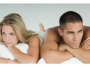 Brooding couple in bed