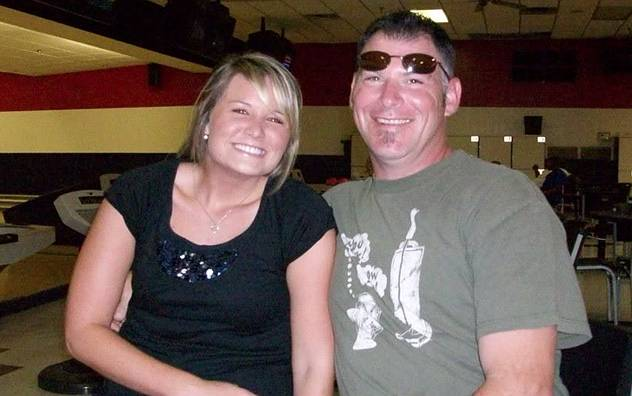 Happy couple in bowling alley