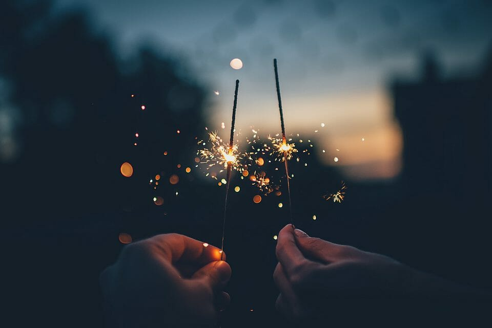 Two hands holding fire crackers