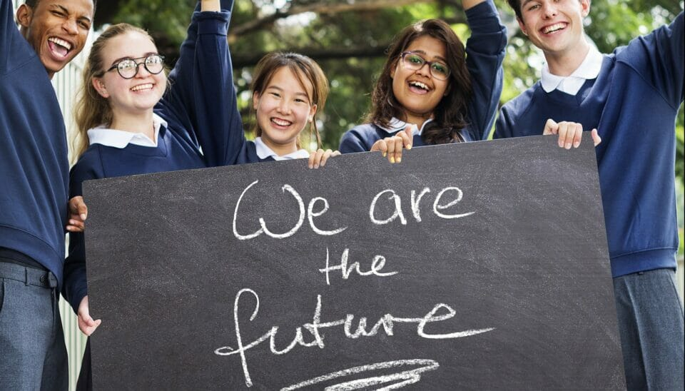 Student leaders holding a sign saying We are the future